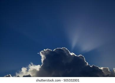 sun behind cumulus clouds natural skyscape background