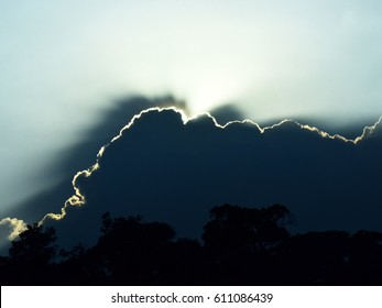 Sun behind dark clouds. Every cloud has a silver lining.