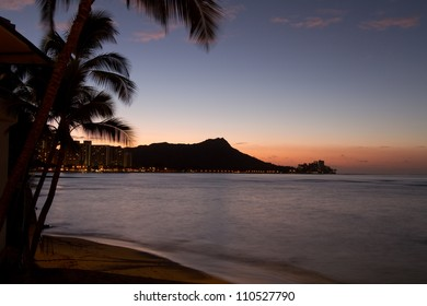Sun behind diamondhead Oahu Hawaii
