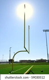 Sun Behind Goal Posts on American Football Field