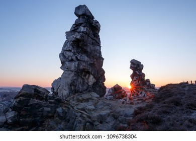 Sun between two stone towers devils wall in the Harz mountains