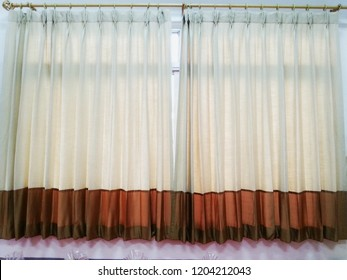 Sun blinds have a hanging loop with a wooden rail.