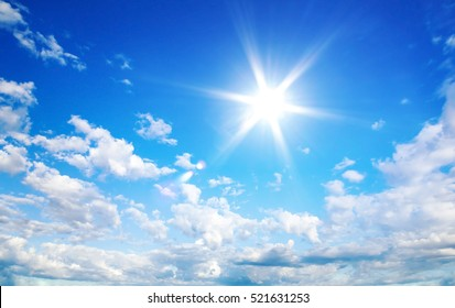 Sun in blue sky with cloud