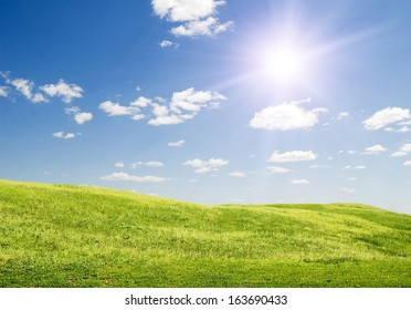 sun blue sky and green grass