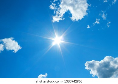 Sun in blue sky. Sunshine in blue sky with white clouds