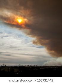 Sun breaking through bushfire smoke clouds over the Parramatta Skyline in Sydney, NSW, Australia