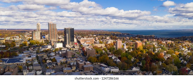 The Sun breaks through clouds hitting and illuminating the urban core of New Rochelle New York