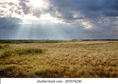 Sun breaks through clouds over the steppes of Kazakhstan