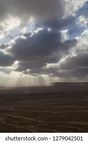 The sun breaks through the clouds at a wadi in the Sulatante of Oman
