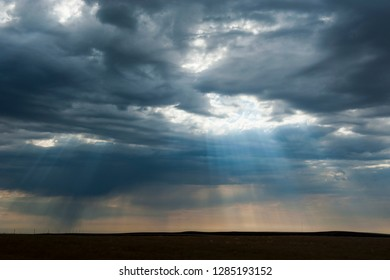 Sun breaks through the dark clouds near the Minuteman nuclear missile site, South Dakota, USA