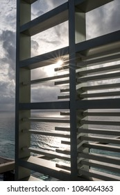Sun burst through hotel lattices over Cancun Beach
