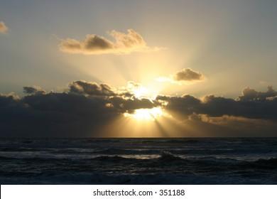 Sun bursting Clouds