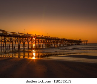 Sun bursting through the 2nd Avenue Pier at sunrise in Myrtle Beach, South Carolina