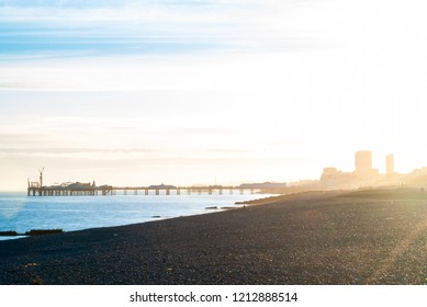 Sun causing flare over the silhouetted skyline of Brighton