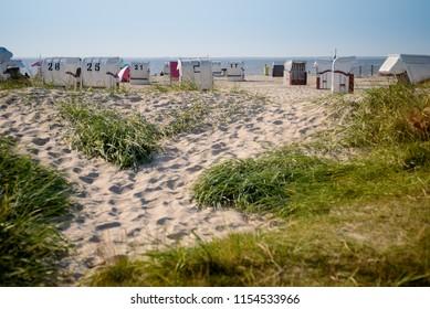 Sun chairs at german north sea beach at late afternoon