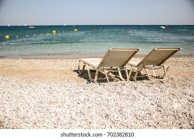 sun chairs on beach