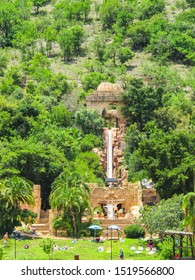 Sun City, South Africa - December 11, 2014:  Temple of courage 17 metre adrenaline rush down a 70 metre drop down an almost vertical water slide against a green hillside with people in Summer
