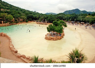 SUN CITY, SOUTH AFRICA - JANUARY 03,2008: large scenic pool with waves and sand beach in Lost City park, Sun City, South Africa.