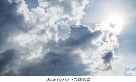 Sun and cloud in the sky.