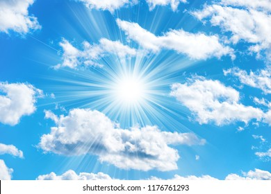 Sun and clouds on blue sky as nature background