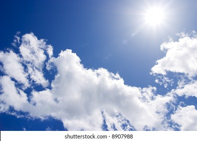 The sun and clouds on blue sky.