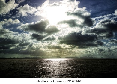 Sun in the clouds over the sea