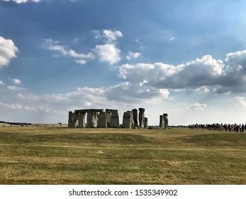 Sun and clouds at Stonehenge, UK.