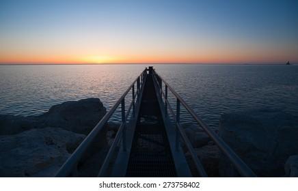 The Sun Comes up Over Lake Michigan Milwaukee Harbor