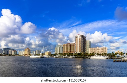 Sun coming down at Fort Lauderdale canals. Abbreviated Ft. Lauderdale is known as the Venice of America, due to its extensive and intricate canal system. Yachts moored on canal against cloudy sky.