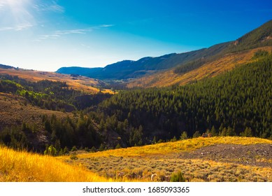 Sun coming over the mountains at the Big Horn National Forest in northern Wyoming