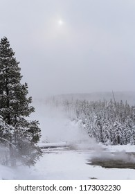 Sun coming through the cloud on a winters day - Yellowstone National Park, USA