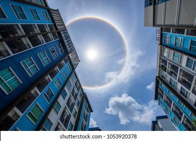 sun corona rainbow clouds and blue sky background , Circumscribed halo