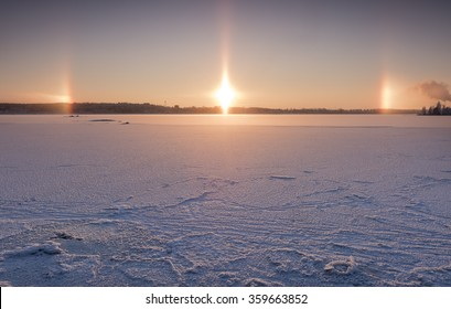 Sun dogs with lake view at the time of blue moment