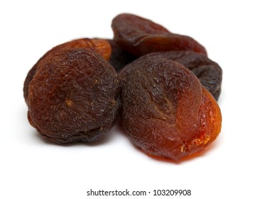sun dried apricots isolated on white