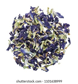 Sun dried butterfly pea flowers isolated on white. Blue herbal tea. Top view.