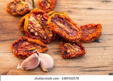Sun dryed tomatoes with garlic. Macro image.