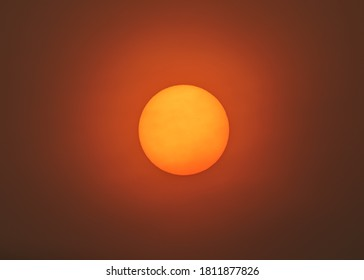 Sun filter through smoky skies of California wildfires 2020. Smoke and ash particles creating eerie sun glow in San Francisco Bay Area.