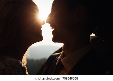 Sun flare between smiling happy couple. Love concept