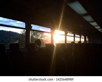 Sun flare through window of train in England