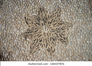 Sun flower made old natural stone pavement