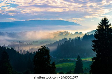 sun and fog in Asiago in aearly morning photo