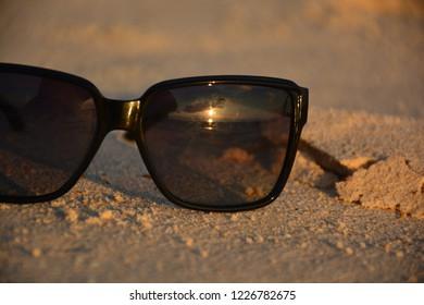 Sun glass at beach during sunset