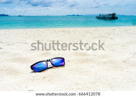 c09fc26775ae Sun glasses on the white sand at the beach of lipe island,turquoise Ocean  beach