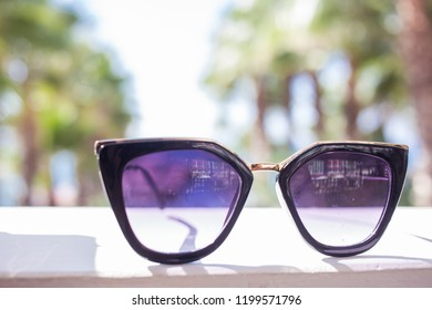Sun glasses and sea view. The rest and holidays concept related