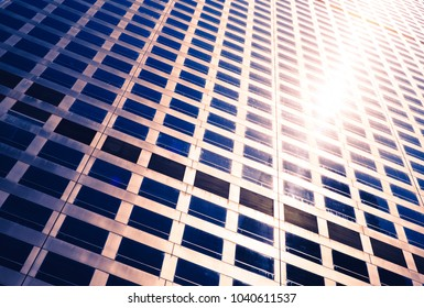 sun glow between the windows of the skyscraper