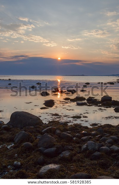 Sun goes down in the clouds at Cape Labyrinths of Greater Solovetsky Island