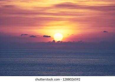 The sun goes down on the ocean horizon