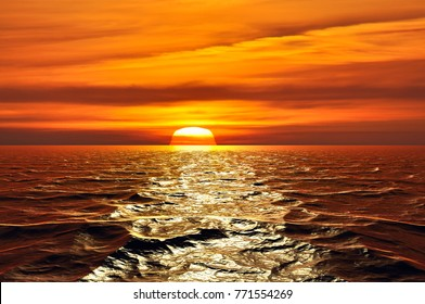 Sun going behind the horizon on the sea at sunset