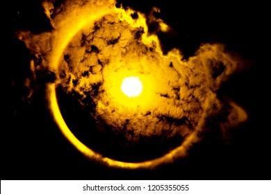Sun halo phenomenon background, silhouette tone.