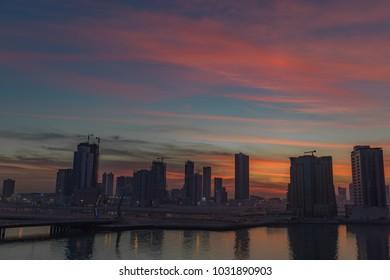 The sun has set over Bahrain as evening colors dance above the skyline.
